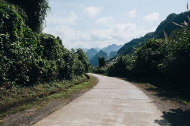 Rural road in beautiful mountains at Phong Nha Ke Bang National Park, Vietnam stock vector