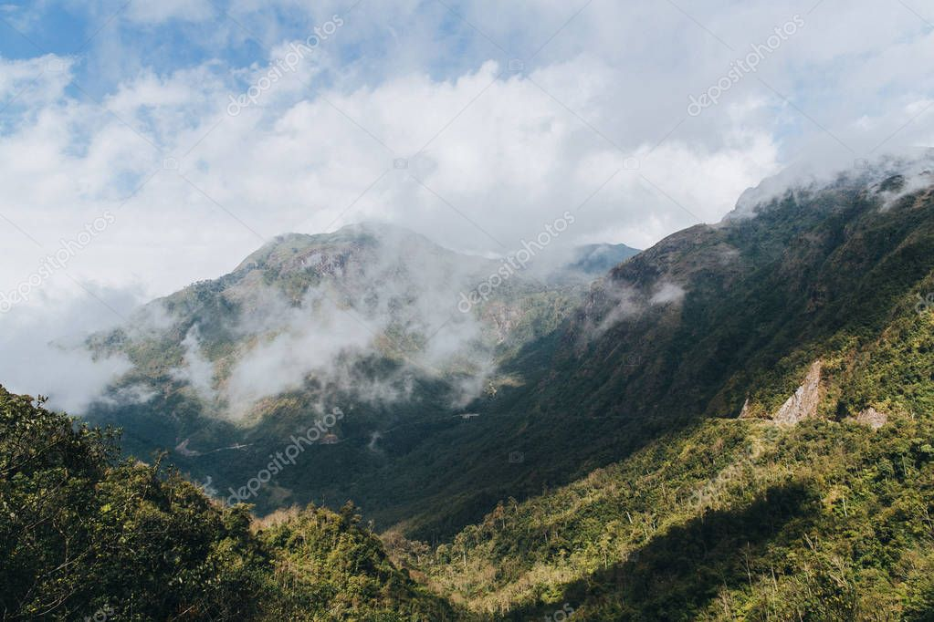 beautiful landscape with green vegetation on mountains and cloudy sky in Sa Pa, Vietnam