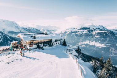 MAYRHOFEN, AUSTRIA - FEBRUARY 19, 2018: mayrhofen ski resort and majestic winter mountain landscape, austria stock vector