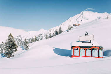 MAYRHOFEN, AUSTRIA - FEBRUARY 19, 2018: cable car in beautiful snow-covered winter mountains at mayrhofen ski resort, austria stock vector
