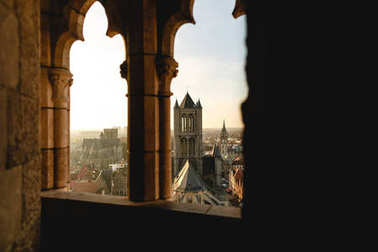 view through ancient window at beautiful historical cityscape of Ghent, Belgium