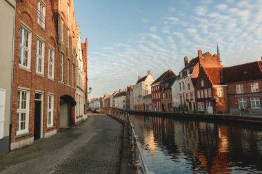 BRUGGE, BELGIUM - NOVEMBER 02, 2016: pavement, beautiful colorful houses and canal in brugge, belgium stock vector