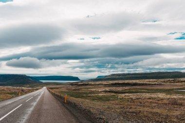 Majestic icelandic landscape and empty asphalt road, western iceland stock vector