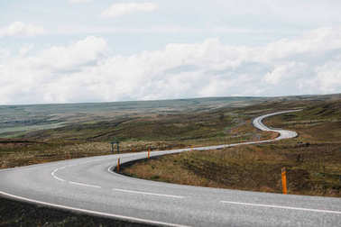 Beautiful icelandic landscape with empty asphalt road stock vector