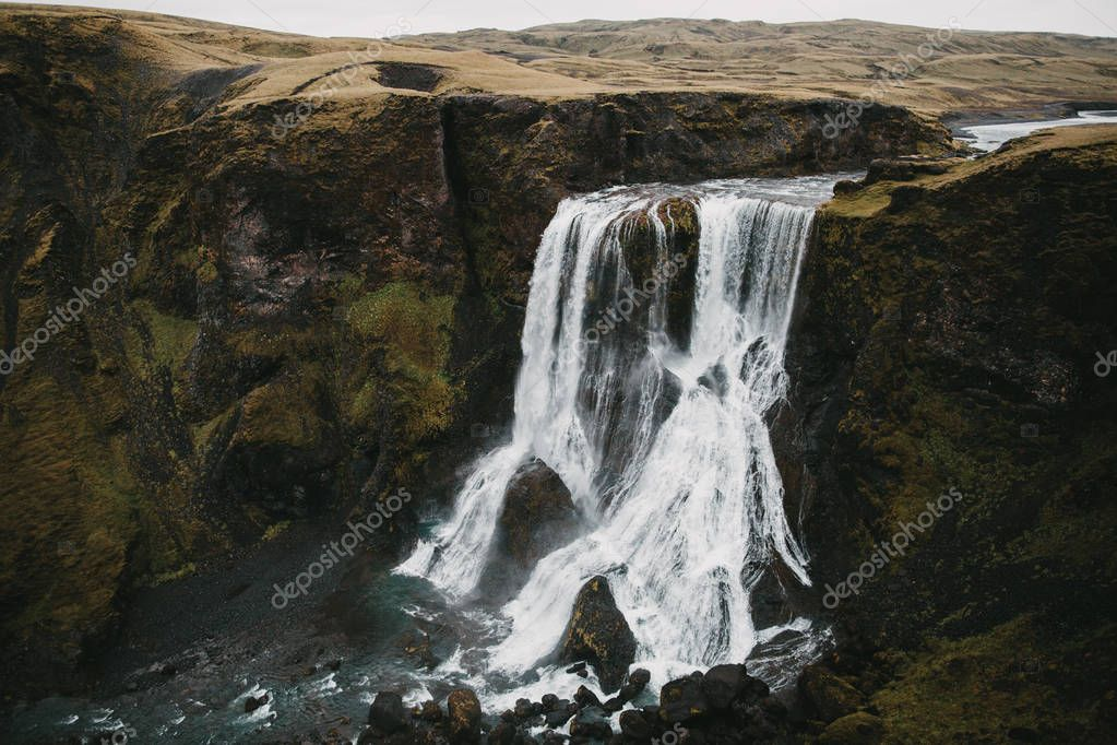aerial view of spectacular Fagrifoss waterfall and rocks in iceland