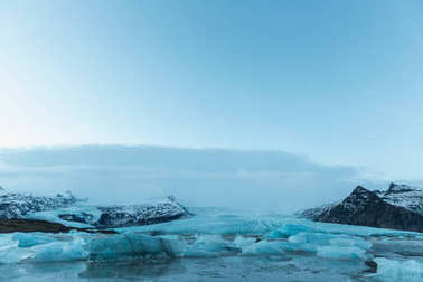 Beautiful icelandic landscape with melting icebergs in cold water, Iceland, Jokulsarlon lagoon stock vector