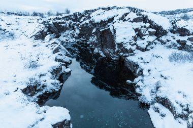 snow-covered rocks