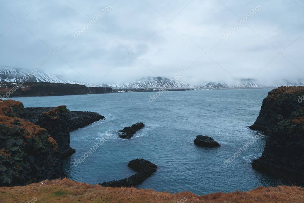 majestic landscape with scenic fjord and rocky mountains in snow, iceland