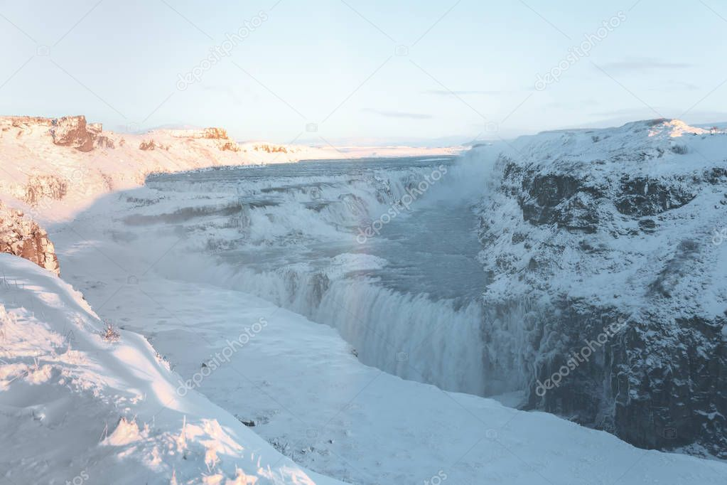 beautiful icelandic landscape with snow-covered rocks and Gullfoss waterfall