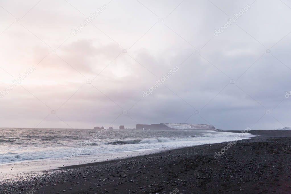 majestic seacoast with wavy sea and cliffs, vik dyrholaey, reynisfjara beach, iceland