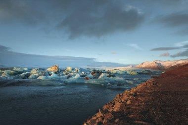 Beautiful scenic view of icebergs floating in water, Iceland, Jokulsarlon lagoon stock vector