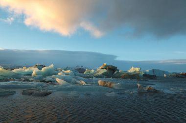 Beautiful scenic landscape with icebergs floating in water, Iceland, Jokulsarlon lagoon stock vector
