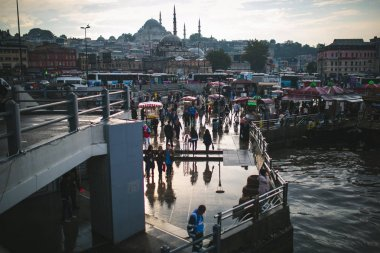 ISTANBUL, TURKEY - OCTOBER 09, 2015: tourists walking on pier stock vector
