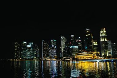 SINGAPORE - JAN 19, 2016: urban view of buildings and city river at night stock vector