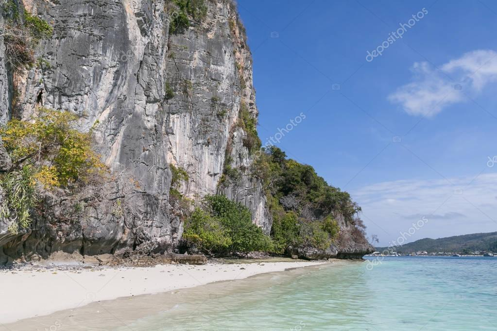 Beautiful scenic view of rocky formations covered with plants and ocean, phi phi islands