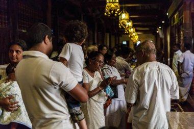 KANDY, SRI LANKA - JAN 17, 2017: hindu people in religious temple, Asia stock vector