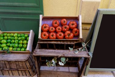 Close-up shot of red and green tomatoes selling on street of old european town, Antibes, France stock vector