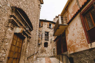 bottom view of narrow street with ancient buildings at old town, Peille, France