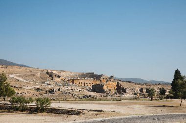 beautiful architecture, rural road and mountains on horizon in pamukkale, turkey