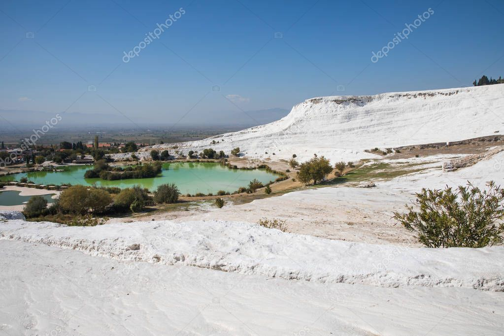 majestic landscape with famous white geological formations and pool in pamukkale, turkey