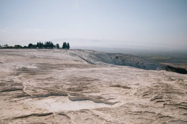 spectacular view of beautiful white limestone in pamukkale, turkey