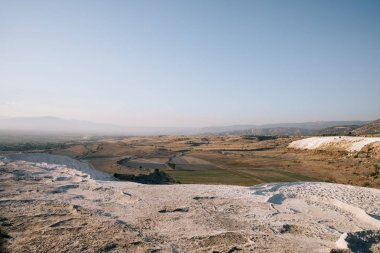majestic landscape with white rocks and beautiful mountains in pamukkale, turkey