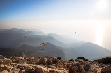Spectacular view of paragliders in sky over rocky mountains, babadag, turkey stock vector