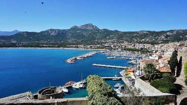 Look at the town of Calvi and its port. Much visited by tourists town is town of Calvi, Corsica.