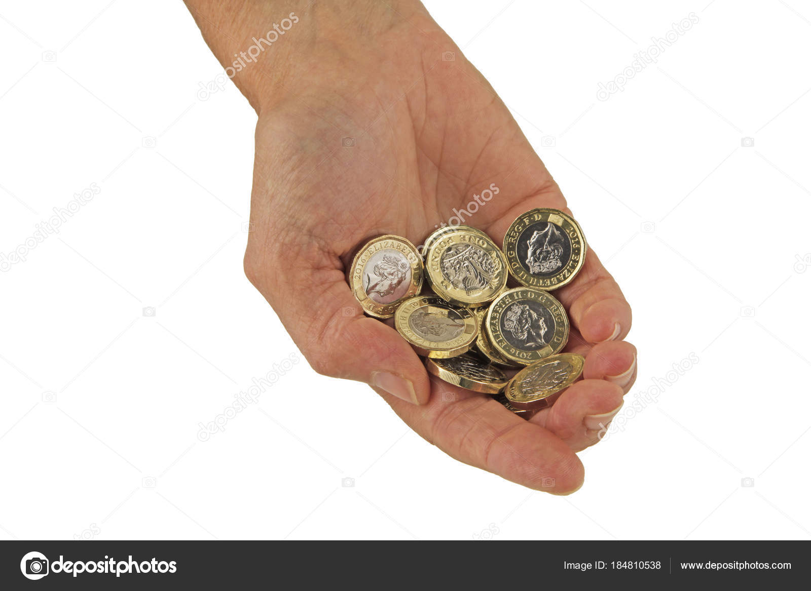money hand ten sterling one pound coins held hand isolated stock