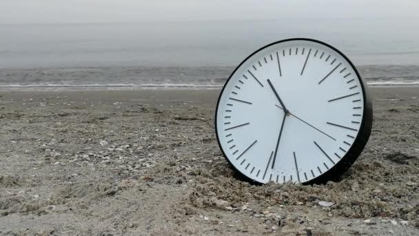 Time Concept, Clock On Sand Beach, Background Walking Couple Legs Sea Horizon