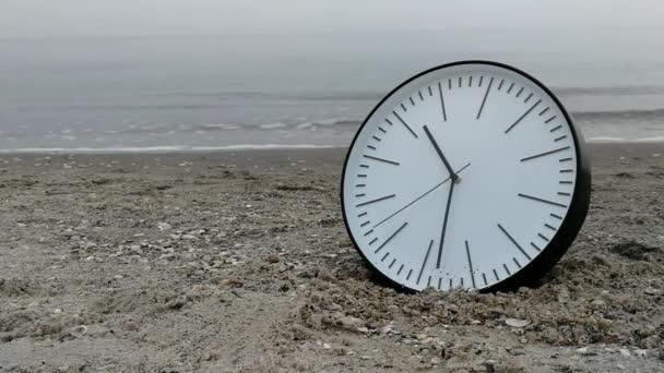 Time Concept, Clock On Sand Beach, Background Walking Man Sea Sky