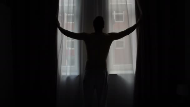 Man Silhouette Moving Curtain, Looking Out Of Window At Street