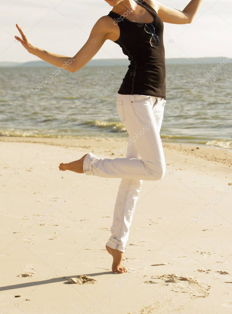 happy girl on the beach, part of the bod, dancing on sand