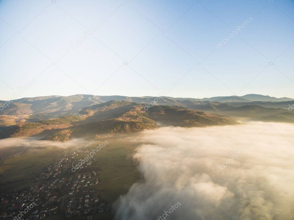 aerial view of beautiful green hills and houses under clouds, Germany