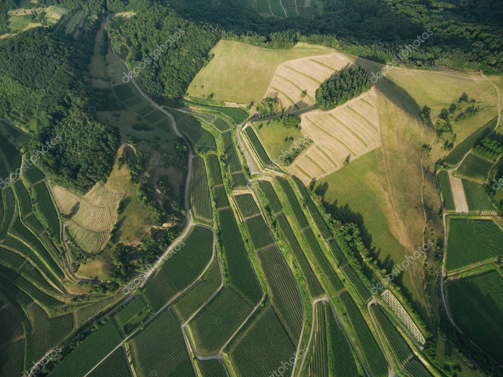aerial view of beautiful agricultural fields and green hills, europe