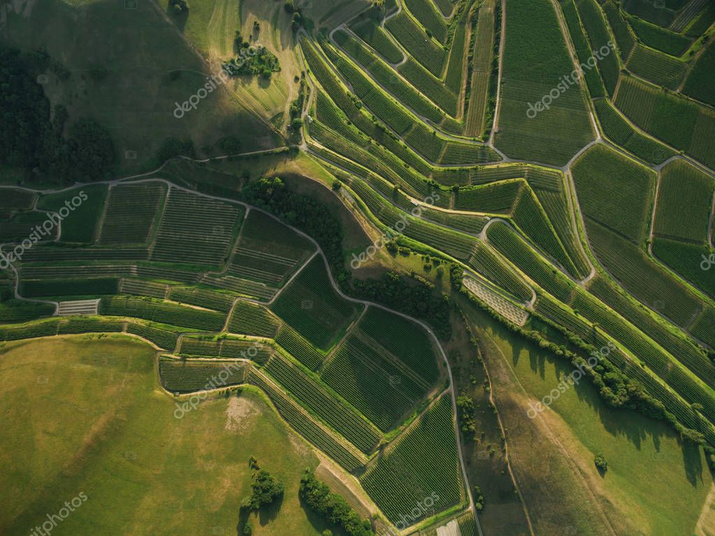 aerial view of green agricultural fields and hills, europe