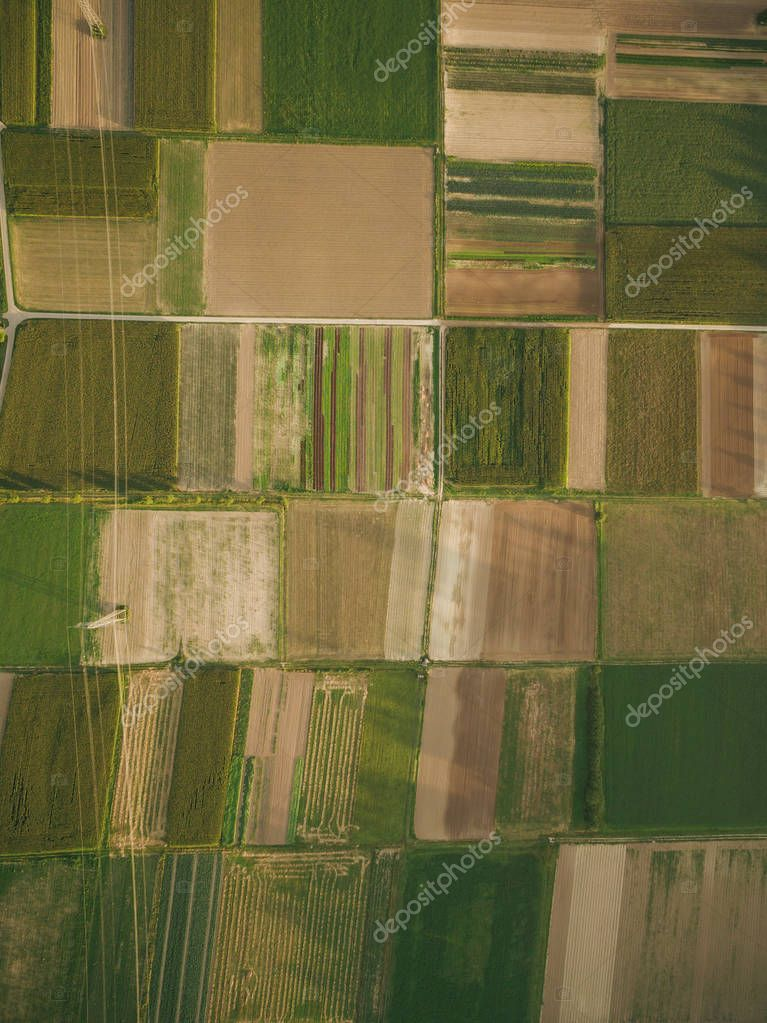 aerial view of agricultural fields with power line, europe