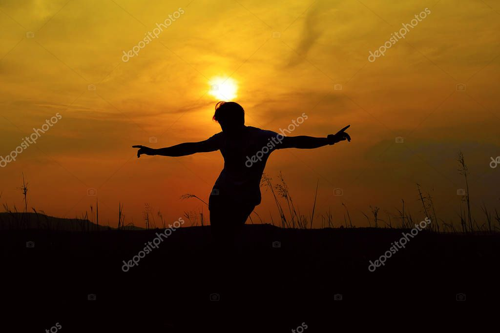Silhouette of a Hip Hop Dancer posing near mountain at sunset, Pune, Maharashtra.