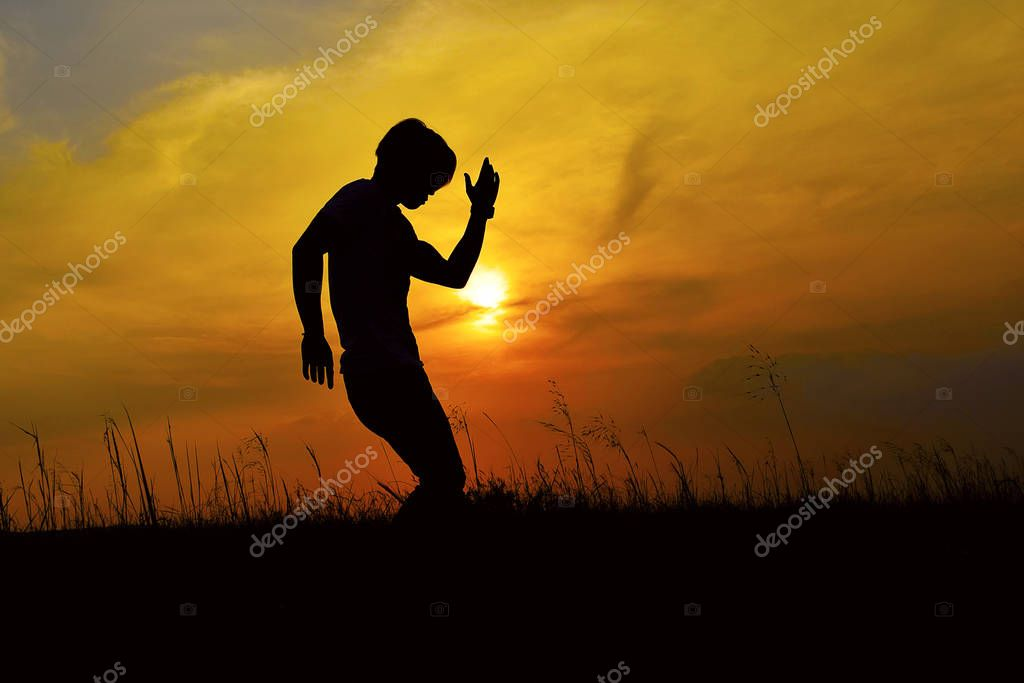 Silhouette of a Hip Hop Dancer posing near mountain at sunset, Pune, Maharashtra.