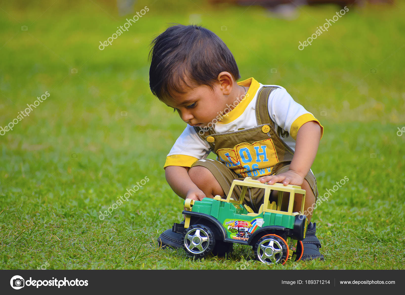 cute baby playing with toy car , pune, maharashtra. — stock photo