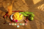 Fotografie Alphonso mango sliced in dish with raw mangoes, mango leaves and stethoscope