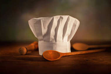 chef's hat with wooden spoon