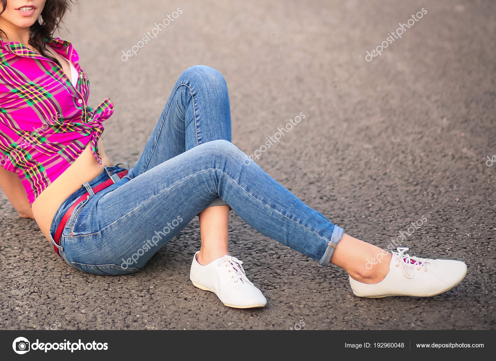 Sexy smiling girl in jeans and shoes