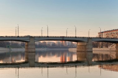 View on Moskva river at a sunrise and Nosospassky bridge. Russia. Moscow.