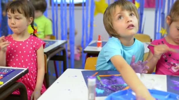 Happy Kids Painting at Kindergarten