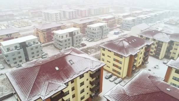 Aerial view of residential area, snowing, winter time