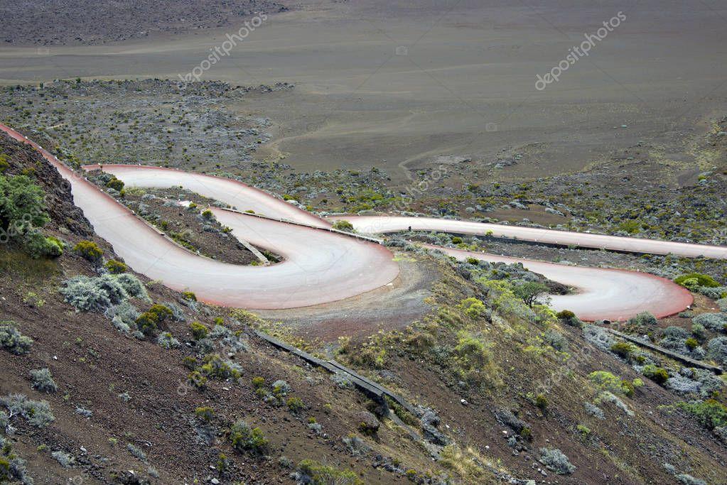 Road in volcanic landscape of Plaine des Sables, Reunion Island National Park