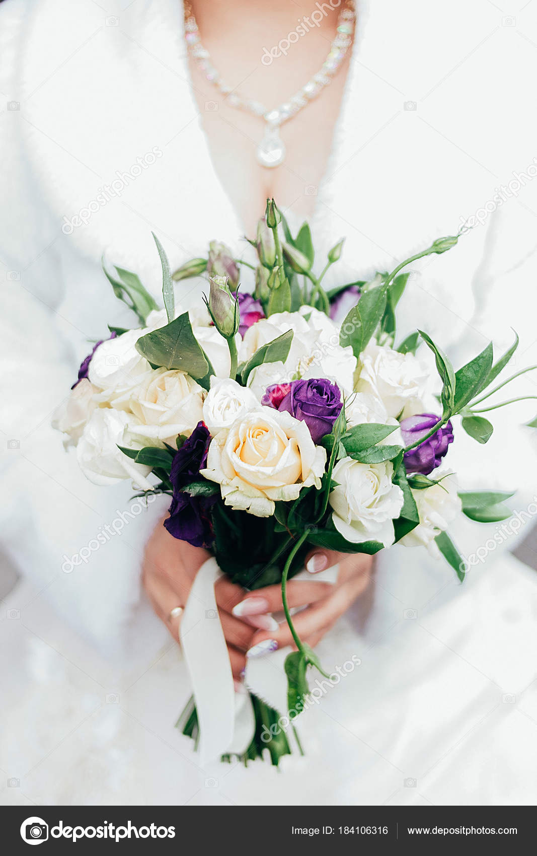 One White Wedding Bouquet Holding In The Hands Stock Photo