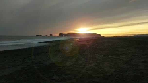 Sunset of Iceland black sand beach