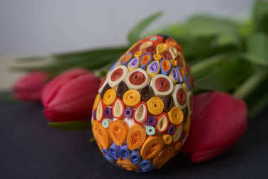 Easter egg and red tulips